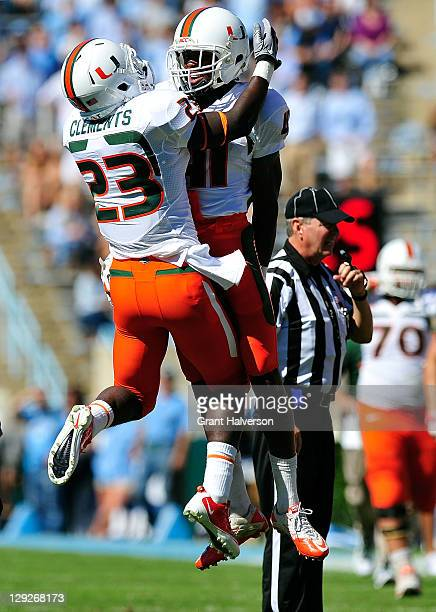 Eduardo Clements and Mike Williams of the Miami Hurricanes celebrate after Clement's touchdown against the North Carolina Tar Heels at Kenan Stadium...