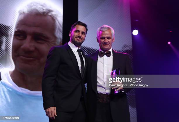 Eduardo Coco Oderigo poses with the World Rugby via Getty Images Award for Character alongside Gus Pichot the World Rugby via Getty Images...