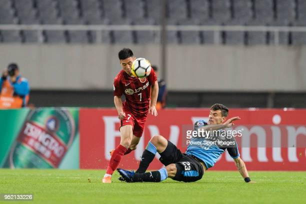 Eduardo da Silva Neto of Kawasaki Frontale battles for the ball with Shanghai FC Forward Wu Lei during the AFC Champions League 2018 Group Stage F...