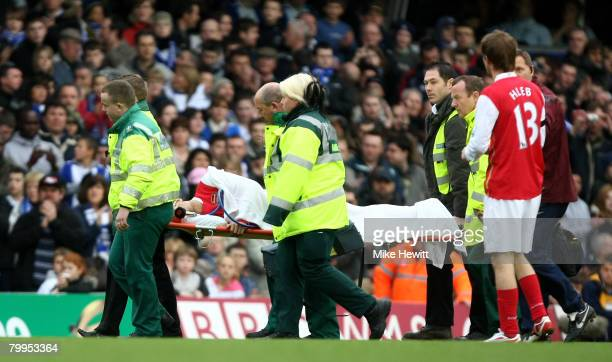 Eduardo da Silva of Arsenal is stretchered off after breaking his leg during the Barclays Premier League match between Birmingham City and Arsenal at...