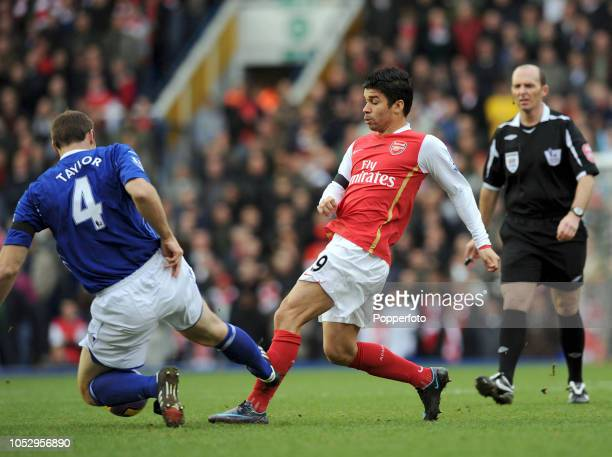 Eduardo da Silva of Arsenal is tackled by Martin Taylor of Birmingham City during the Barclays Premier League match between Birmingham City and...