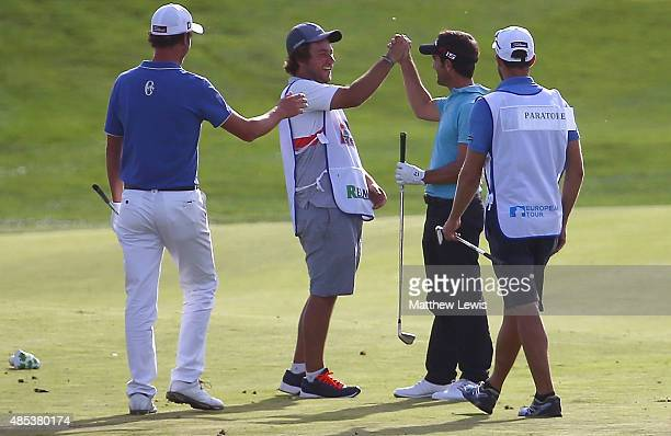 Eduardo De La Riva of Spain celebrates with his caddie after he made an eagle on the 18th hole during day one of the DD Real Czech Masters at...