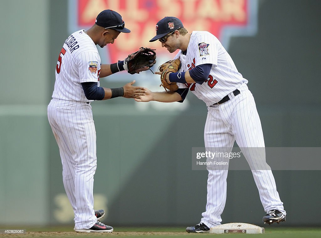 Eduardo Escobar #5 and Brian Dozier #2 of the Minnesota Twins celebrate a winning a game against the Chicago White Sox on July 27, 2014 at Target Field in Minneapolis, Minnesota. The Twins defeated the White Sox 4-3.