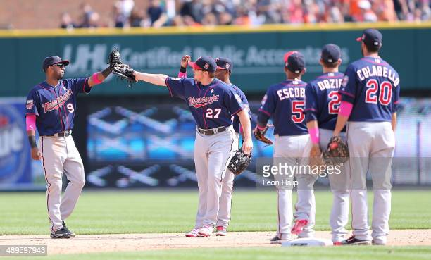 Eduardo Escobar and Chris Parmelee of the Minnesota Twins celebrate a win over the Detroit Tigers at Comerica Park on May 11, 2014 in Detroit,...