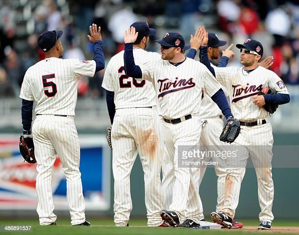 Eduardo Escobar Chris Colabello Jason Kubel Pedro Florimon and Sam Fuld of the Minnesota Twins celebrate a win of the game against the Detroit Tigers...