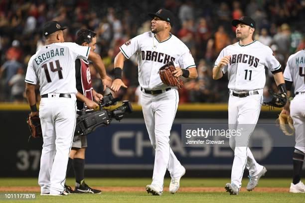 Eduardo Escobar David Peralta and AJ Pollock of the Arizona Diamondbacks celebrate after closing out the MLB game against the San Francisco Giants at...