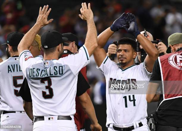 Eduardo Escobar of the Arizona Diamondback celebrates with teammate Daniel Descalso after hitting a game winning home run in the bottom of the ninth...