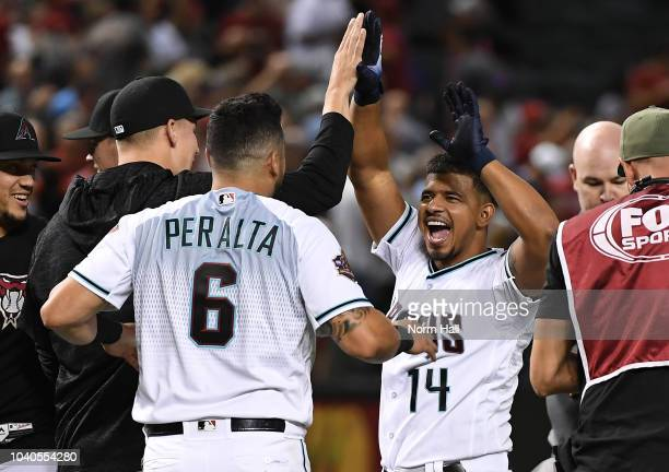 Eduardo Escobar of the Arizona Diamondback celebrates with teammate David Peralta after hitting a game winning home run in the bottom of the ninth...