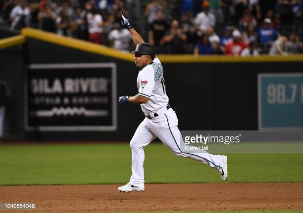 Eduardo Escobar of the Arizona Diamondback rounds the bases after hitting a game winning home run in the bottom of the ninth inning against the Los...
