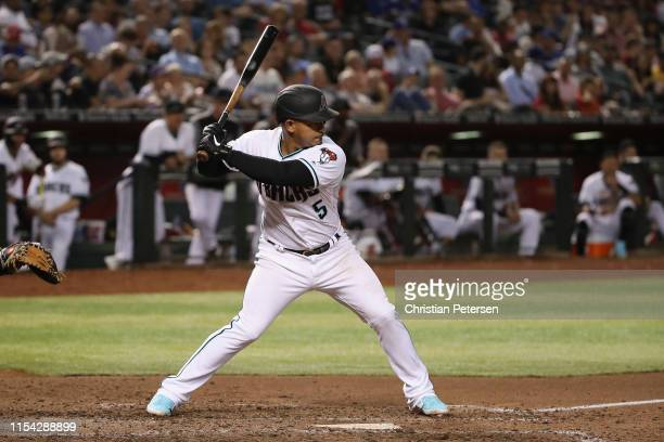 Eduardo Escobar of the Arizona Diamondbacks bats against the Los Angeles Dodgers during the MLB game at Chase Field on June 04 2019 in Phoenix Arizona
