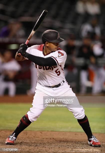 Eduardo Escobar of the Arizona Diamondbacks bats against the Texas Rangers during the MLB game at Chase Field on April 10 2019 in Phoenix Arizona The...