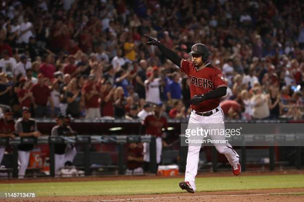 Eduardo Escobar of the Arizona Diamondbacks celebrates after hitting a two-run home run against the Chicago Cubs during the sixth inning of the MLB...