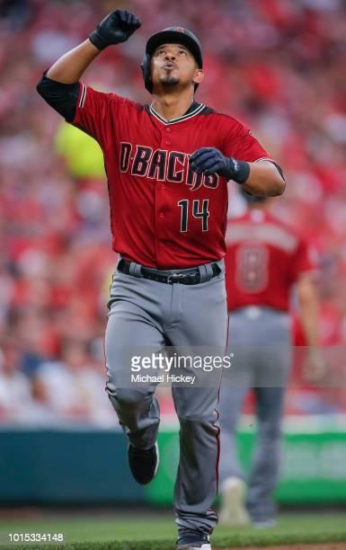 Eduardo Escobar of the Arizona Diamondbacks celebrates as he rounds the bases after hitting a two run homer in the fourth inning against the...
