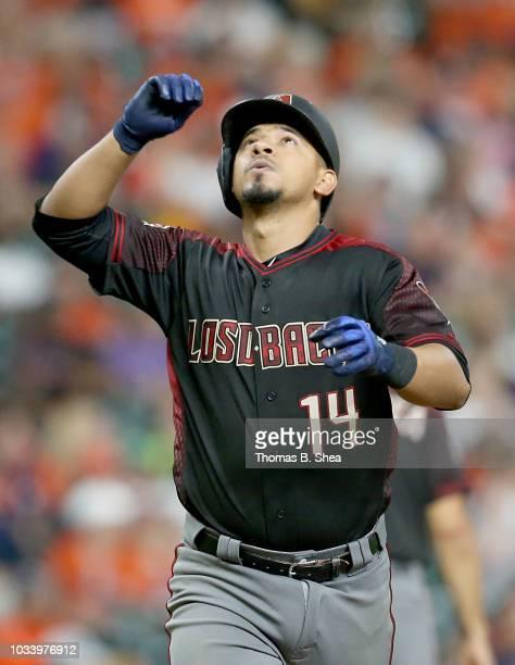 Eduardo Escobar of the Arizona Diamondbacks celebrates hitting a home run against the Houston Astros in the eighth inning at Minute Maid Park on...