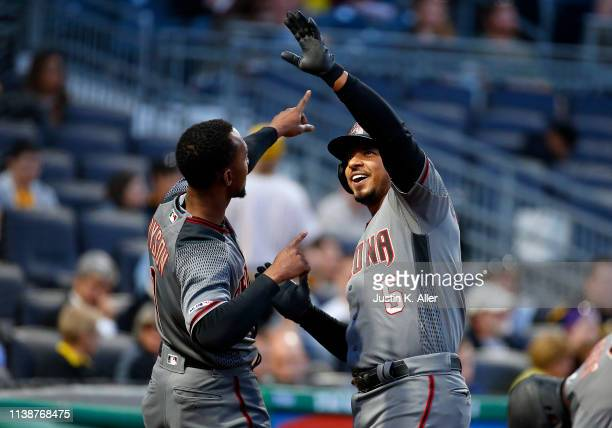 Eduardo Escobar of the Arizona Diamondbacks celebrates with Jarrod Dyson after hitting a home run in the third inning against the Pittsburgh Pirates...