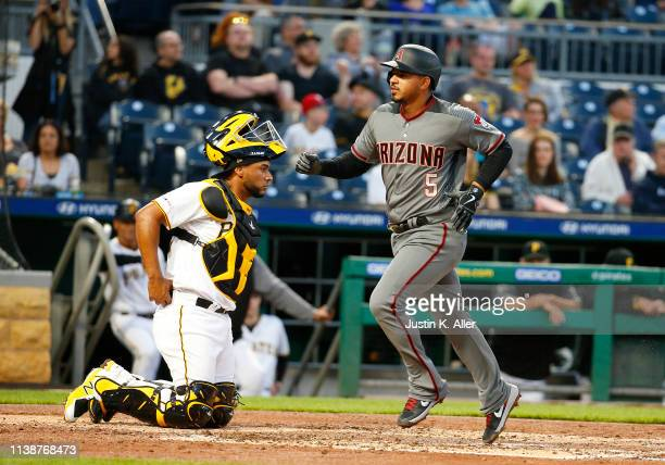 Eduardo Escobar of the Arizona Diamondbacks crosses home after hitting a home run in the third inning against the Pittsburgh Pirates at PNC Park on...