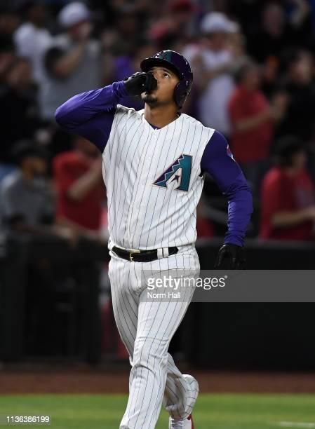 Eduardo Escobar of the Arizona Diamondbacks gestures to the sky after hitting a three run home run during the seventh inning against the San Diego...