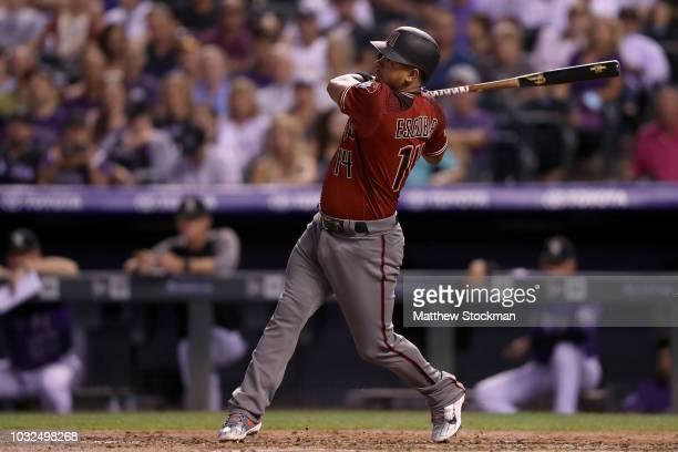 Eduardo Escobar of the Arizona Diamondbacks hits a 2 RBI home run in the third inning against the Colorado Rockies at Coors Field on September 12...