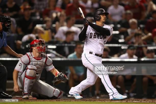 Eduardo Escobar of the Arizona Diamondbacks hits a tworun home run against the Philadelphia Phillies during the fourth inning of the MLB game at...