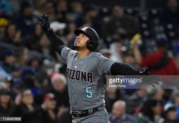 Eduardo Escobar of the Arizona Diamondbacks looks skyward after hitting a solo home run during the fourth inning of a baseball game against the San...