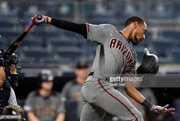 Eduardo Escobar of the Arizona Diamondbacks loses his helmet during his follow through in the fifth inning of the game against the New York Yankees...