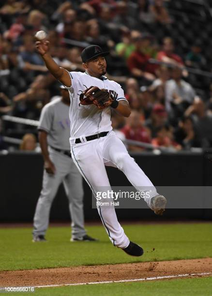 Eduardo Escobar of the Arizona Diamondbacks makes a running throw to first base against the Texas Rangers at Chase Field on July 31 2018 in Phoenix...