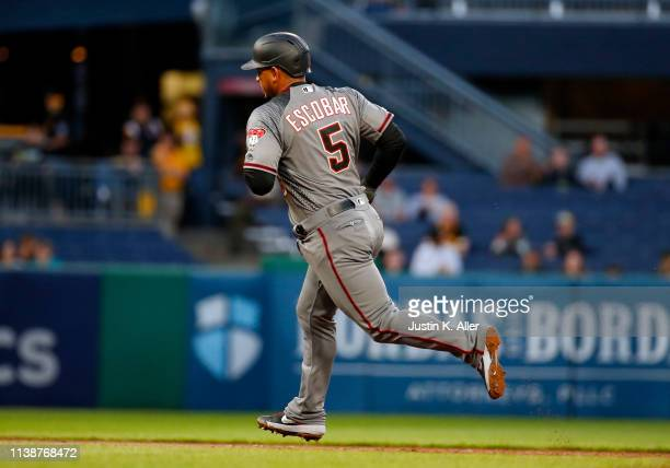 Eduardo Escobar of the Arizona Diamondbacks rounds second after hitting a home run in the third inning against the Pittsburgh Pirates at PNC Park on...