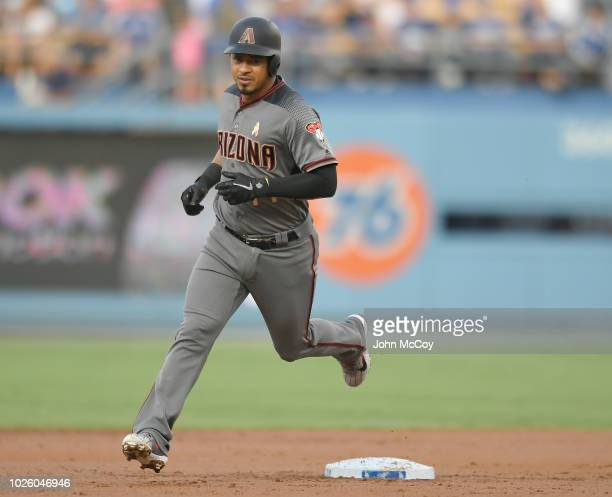 Eduardo Escobar of the Arizona Diamondbacks rounds second base after hitting a home run in the second inning against the Los Angeles Dodgers at...