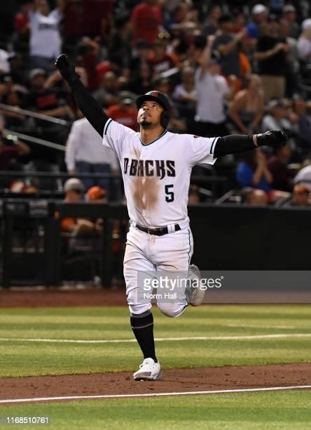 Eduardo Escobar of the Arizona Diamondbacks rounds the bases after hitting a solo home run off of Tony Watson of the San Francisco Giants during the...