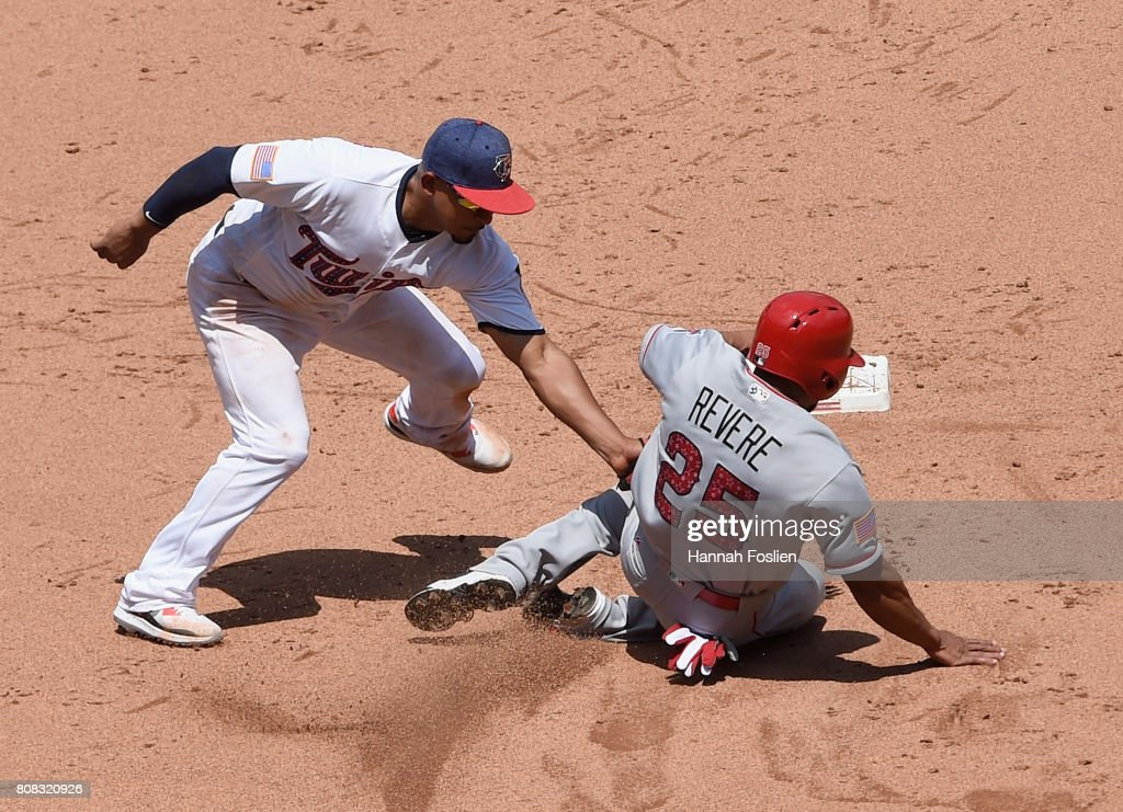 Eduardo Escobar #5 of the Minnesota Twins catches Ben Revere #25 of the Los Angeles Angels of Anaheim stealing second base during the fifth inning of the game on July 4, 2017 at Target Field in Minneapolis, Minnesota. The Twins defeated the Angels 5-4.