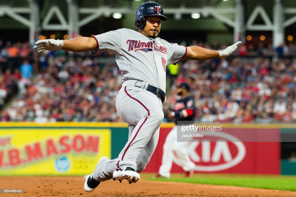 Eduardo Escobar #5 of the Minnesota Twins dives into third base during the first inning against the Cleveland Indians at Progressive Field on September 26, 2017 in Cleveland, Ohio.