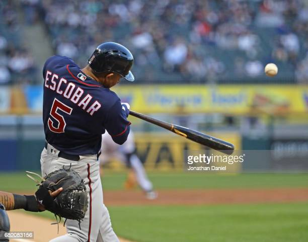 Eduardo Escobar of the Minnesota Twins hits a three run home run in hte first inning against the Chicago White Sox at Guaranteed Rate Field on May 11...