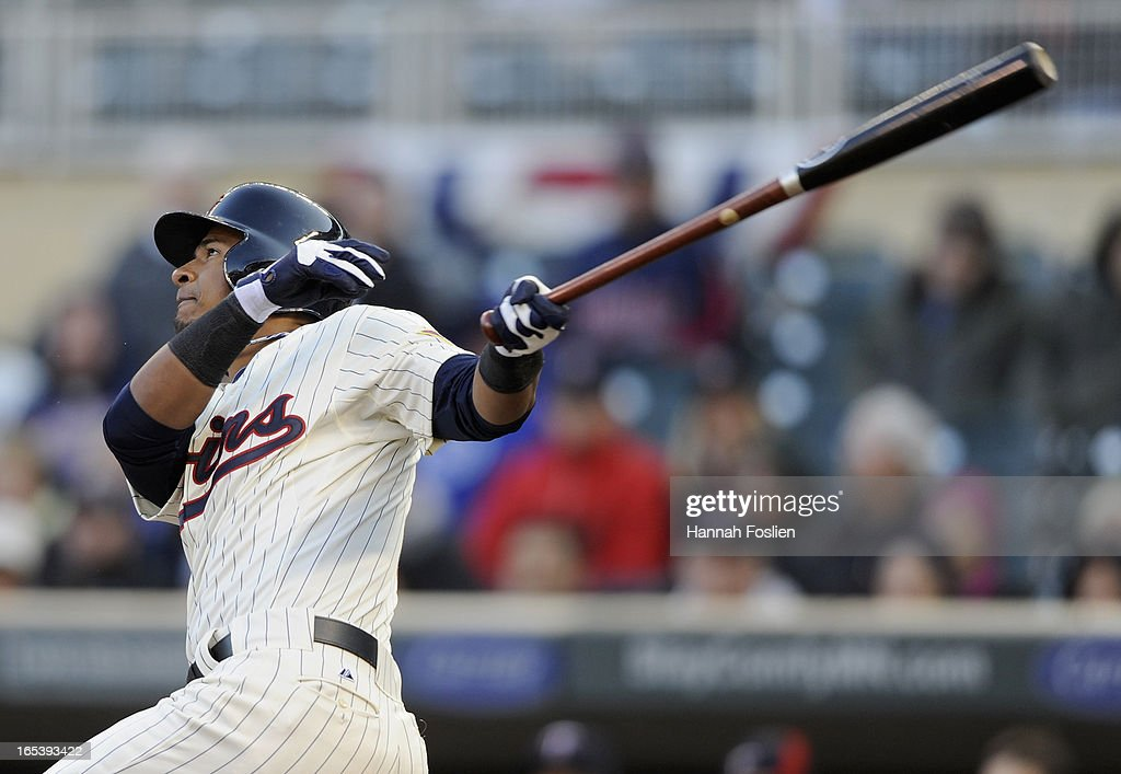 Eduardo Escobar #5 of the Minnesota Twins hits a two RBI double to win the game against the Detroit Tigers during the ninth inning on April 3, 2013 at Target Field in Minneapolis, Minnesota. The Twins defeated the Tigers 3-2.