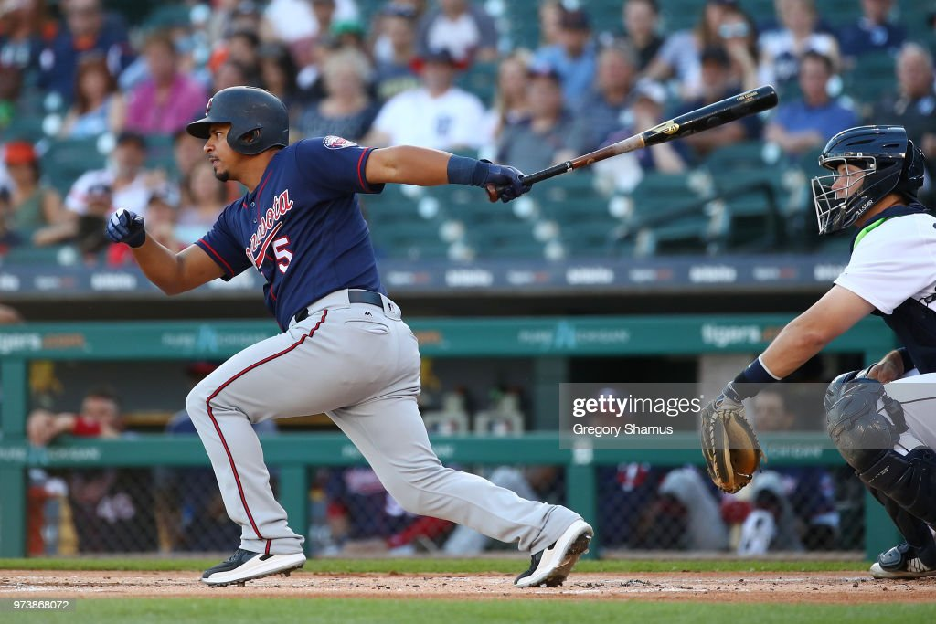 Eduardo Escobar #5 of the Minnesota Twins hits a two run single in the first inning in front of Grayson Greiner #17 of the Detroit Tigers at Comerica Park on June 13, 2018 in Detroit, Michigan.
