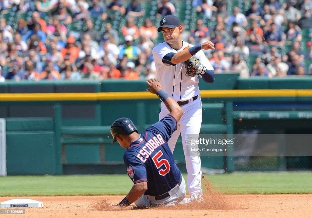 Eduardo Escobar #5 of the Minnesota Twins is out at second base as Jose Iglesias #1 of the Detroit Tigers throws to first base during the game at Comerica Park on May 14, 2015 in Detroit, Michigan. The Tigers defeated the Twins 13-1.
