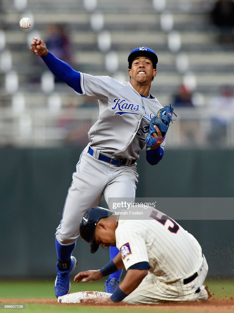 Eduardo Escobar #5 of the Minnesota Twins is out at second base as Raul Mondesi #27 of the Kansas City Royals turns a double play during the seventh inning of game two of a doubleheader on May 21, 2017 at Target Field in Minneapolis, Minnesota. The Twins defeated the Royals 8-4.