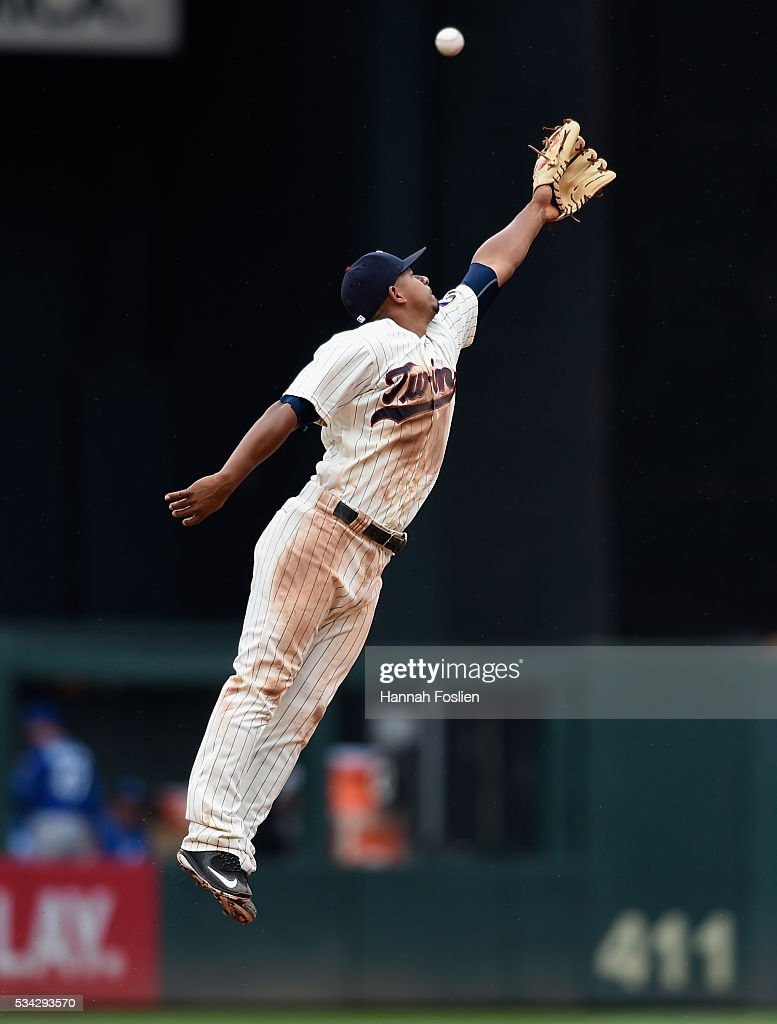 Eduardo Escobar #5 of the Minnesota Twins is unable to catch an RBI triple by Omar Infante #14 of the Kansas City Royals at shortstop during the fourth inning of the game on May 25, 2016 at Target Field in Minneapolis, Minnesota. The Twins defeated the Royals 7-5.