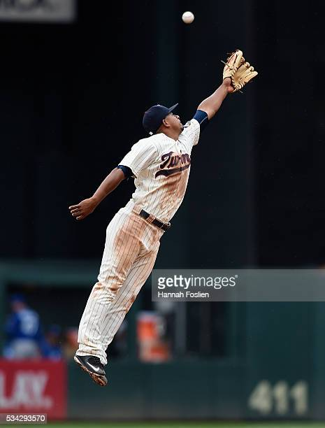 Eduardo Escobar of the Minnesota Twins is unable to catch an RBI triple by Omar Infante of the Kansas City Royals at shortstop during the fourth...