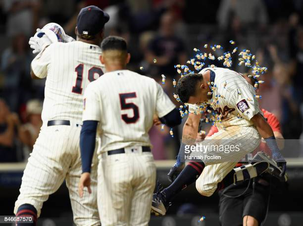 Eduardo Escobar of the Minnesota Twins looks on as teammate Kennys Vargas congratulates Eddie Rosario on hitting a walkoff tworun home run against...