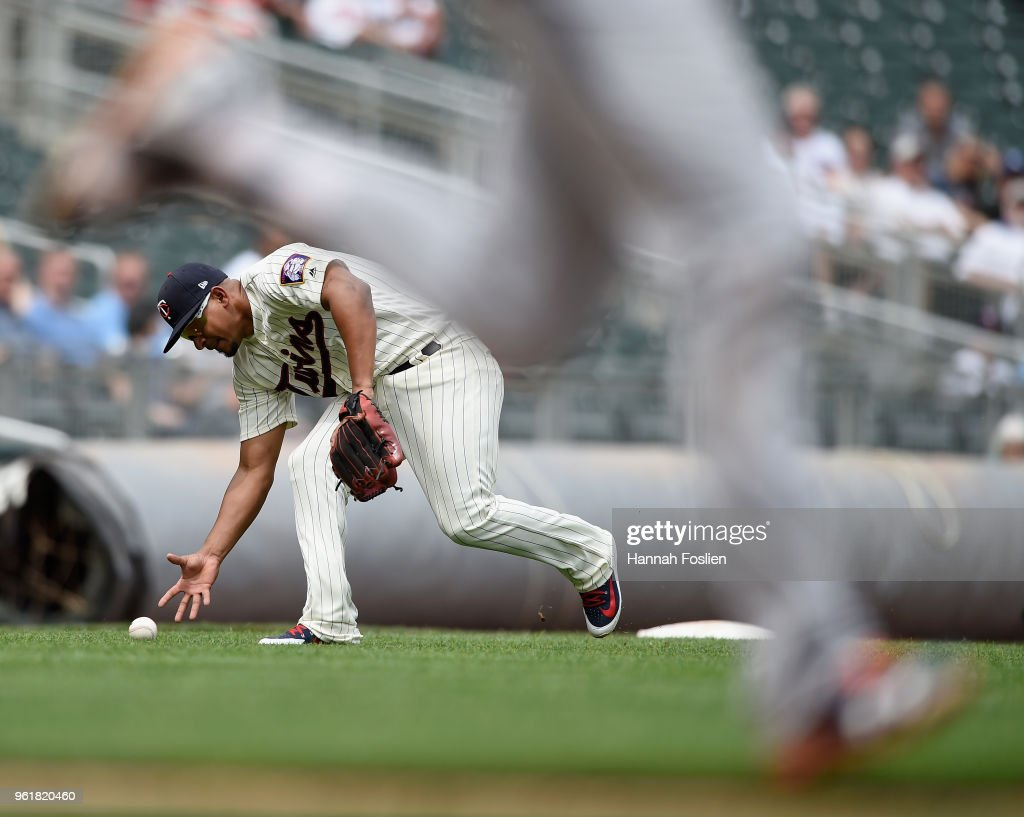 Eduardo Escobar #5 of the Minnesota Twins makes a barehanded play on the ball hit by John Hicks #55 of the Detroit Tigers during the ninth inning of the game on May 23, 2018 at Target Field in Minneapolis, Minnesota. Hicks was safe at first base on the play. The Tigers defeated the Twins 4-1.