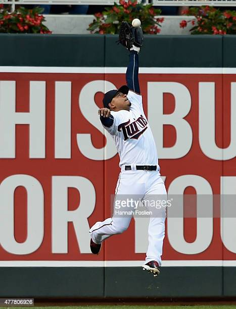 Eduardo Escobar of the Minnesota Twins makes a catch of the ball hit by Miguel Montero of the Chicago Cubs in left field during the fourth inning of...