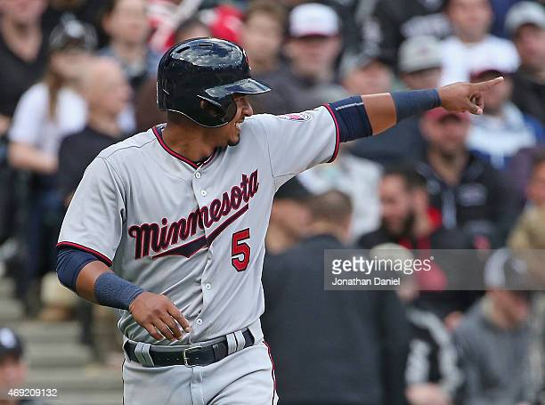 Eduardo Escobar of the Minnesota Twins points to the Chicago White Sox dugout after scoring a run in the 5th inning on a wild pitch during the White...