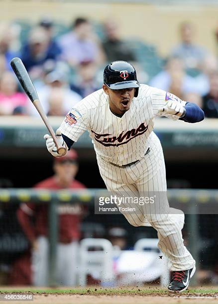 Eduardo Escobar of the Minnesota Twins reacts to being hit in the foot by a pitch during the second inning of the game against the Arizona...