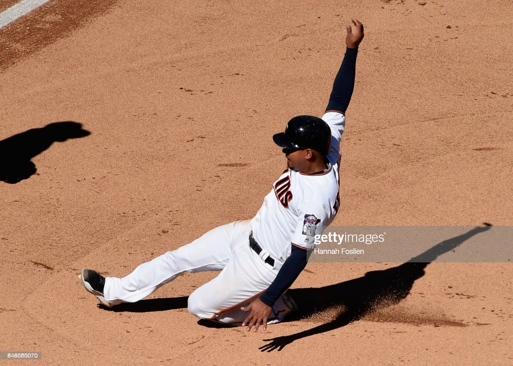 Eduardo Escobar #5 of the Minnesota Twins slides safely into third base against the Toronto Blue Jays during the fifth inning of the game on September 17, 2017 at Target Field in Minneapolis, Minnesota. The Twins defeated the Blue Jays 13-7.