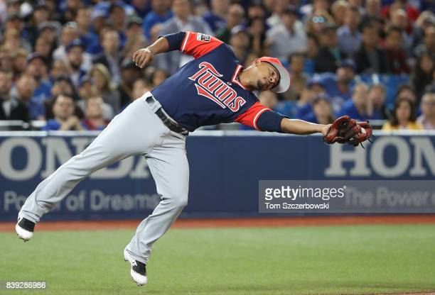 Eduardo Escobar of the Minnesota Twins stumbles after catching a foul pop up in the seventh inning during MLB game action against the Toronto Blue...