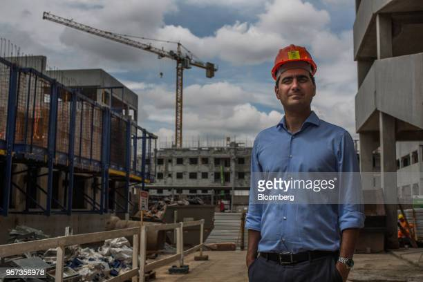 Eduardo Fischer, co-chief executive officer of MRV Engenharia e Participacoes SA, stands for a photograph at the Reserva Paulista residential complex...