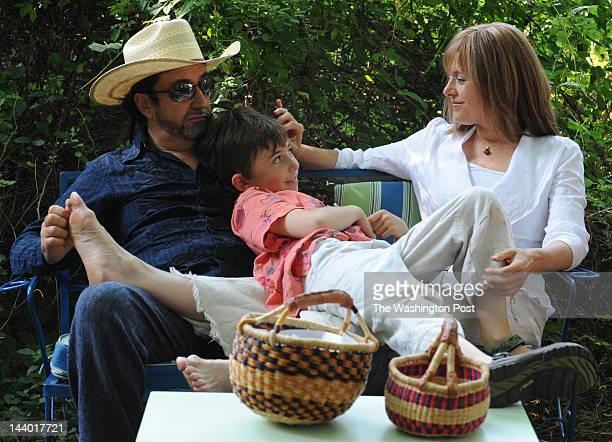 FILE Eduardo Garcia Valseca and Jayne Rager Valseca sit with their son Emiliano 9 in a picnic area on their property in Leesburg Virginia on July 21...