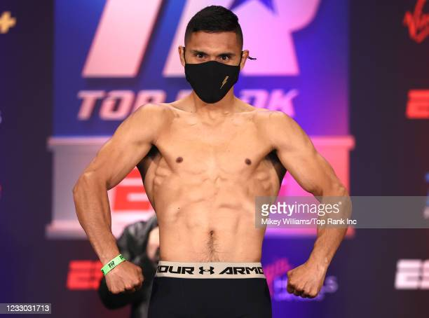 Eduardo Garza flexes on the scale ahead of his fight with Andres Cortes at Virgin Hotels Las Vegas on May 21, 2021 in Las Vegas, Nevada.