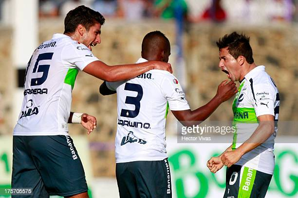 Eduardo Herrera and his teammates of Santos celebrate a goal against Zacatepec during a match between Zacatepec and Santos as part of the Copa MX at...