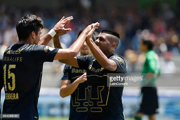 Eduardo Herrera celebrates with Daniel Ludueña of Pumas UNAM after scoring during a match between Pumas UNAM and Xolos Tijuana as a part of 6th round...
